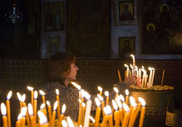 Worshipper-candle-Bethlehem-West-Bank-Advent.jpg