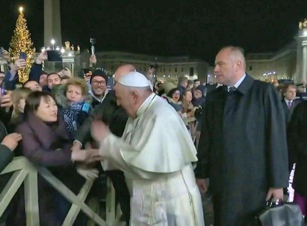 Francis slapping female pilgrim worshiper